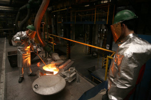 Preparing cast-iron for anode rods in the Rodding Shop.